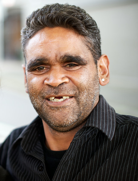 Smiling young Aboriginal man, composed vertically