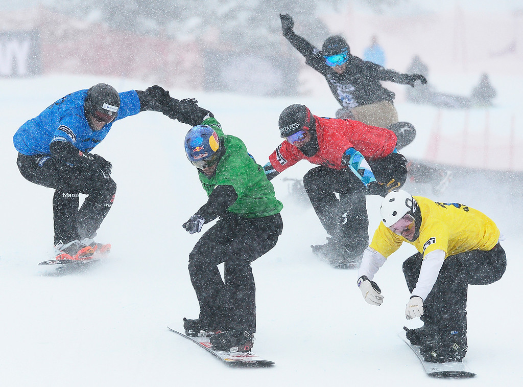 . ASPEN, CO - JANUARY 31: The pack of racers with Jarryd Hughes, yellow, come across the finish line during the men\'s ski cross finals at Winter X Games 2016 at Buttermilk Mountain on January 31, 2016 in Aspen, Colorado. Jarryd Hughes won the event with a time of 0:59.292.  (Photo by Brent Lewis/The Denver Post)
