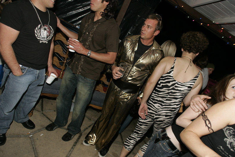Party wasn't complete without dudes wearing gold lamé and a body leotard.