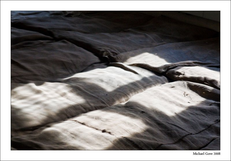 Rudimentary bedding laid on the floor of a hut used when prisoners first arrive (94618857).jpg