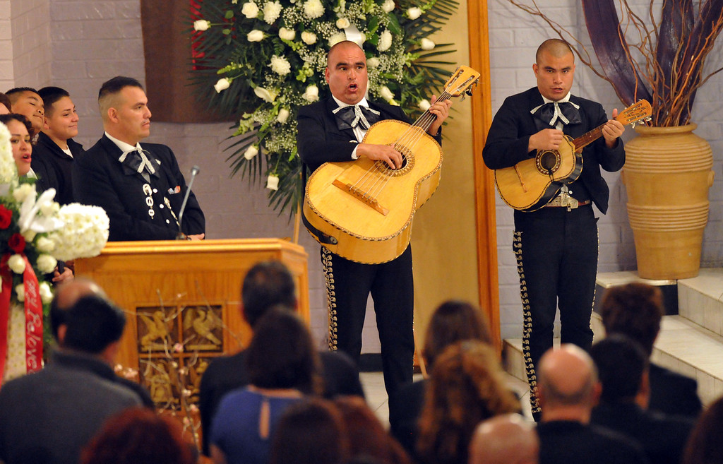 ". Mariachis sing as mourners gather to remember restaurant owner Manuel Rojas during the Rosary service at Assumption Church in Boyle Heights on February 25, 2013. Rojas, owner of Manuel\'s Original El Tepeyac Cafe, he was known for making the famous ""Hollenbeck\"" burrito. (SGVN/Staff Photo by Keith Durflinger)"