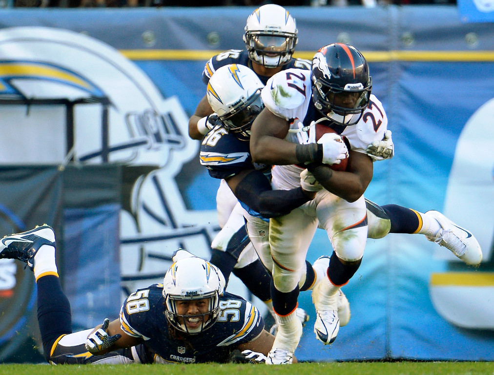 . Running back Knowshon Moreno #27 of the Denver Broncos picks up 6 yards after the catch in the 3rd quarter at Qualcomm Stadium November 10, 2013 San Diego, CA. (Photo By Joe Amon/The Denver Post)