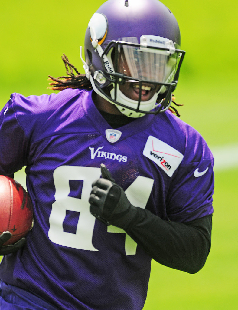 . Vikings rookie wide receiver Cordarrelle Patterson chortles after catching a pass during the team\'s minicamp on Tuesday.  (Pioneer Press: Scott Takushi)