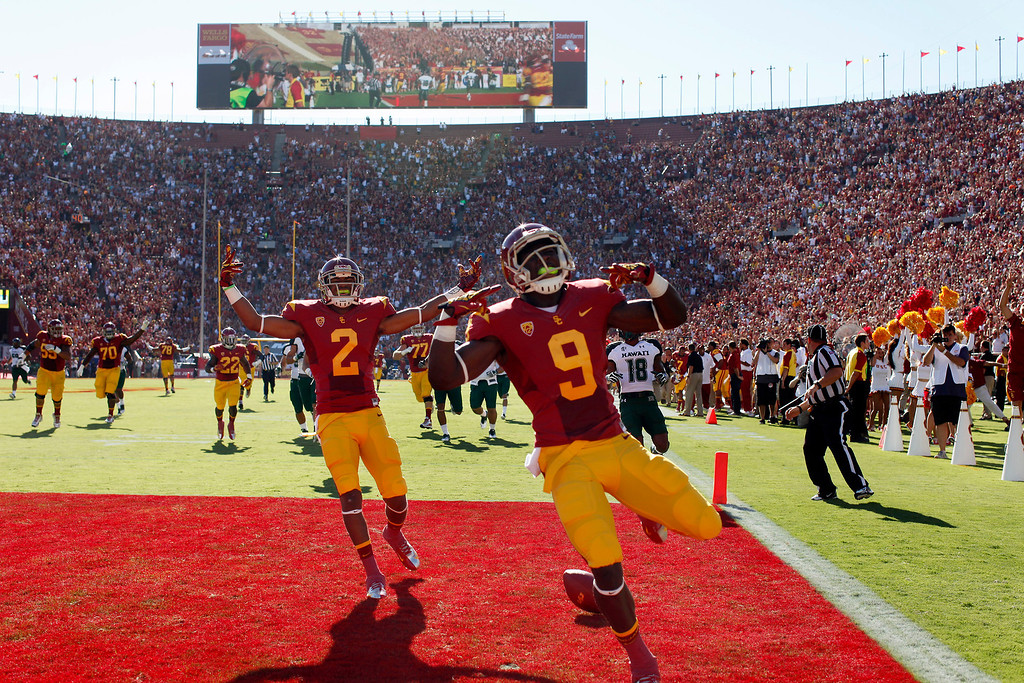 . USC\'s Marqise Lee(#9) celebrates after scoring on a 75-yard pass reception on the first play from scrimmage against Hawaii, Saturday, September 1, 2012, at the Los Angeles Memorial Coliseum. (Michael Owen Baker/L.A. Daily News)