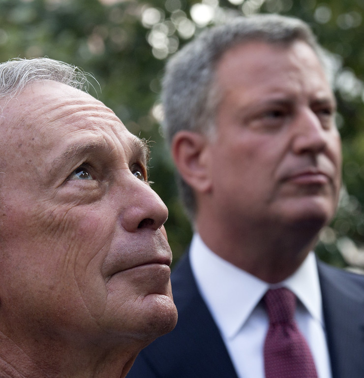 . Mayor Michael Bloomberg stands near mayoral candidate Bill de Blasio (R) during the 9/11 Memorial ceremonies marking the 12th anniversary of the 9/11 attacks on the World Trade Center on September 11, 2013 in New York City.  (Photo by Adrees Latif-Pool/Getty Images)