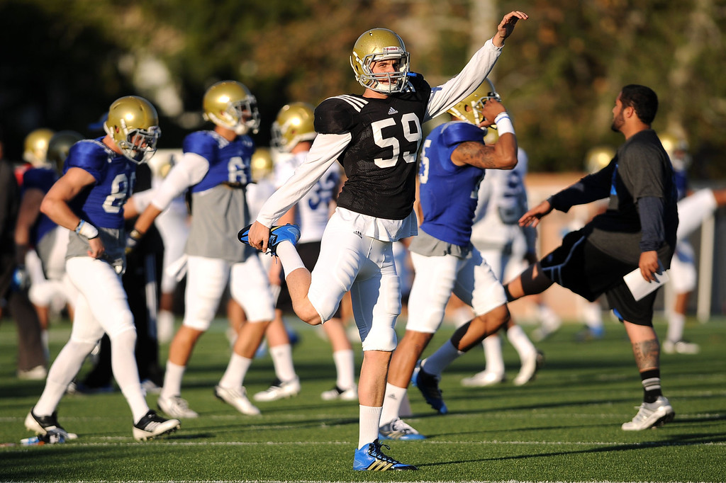 . Christopher Longo stretches during spring practice Monday April 7, 2014 at UCLA.(Andy Holzman/Los Angeles Daily News)