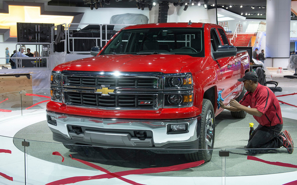 . Fred Quinn, of Detroit, cleans-up a 2014 Chevrolet Silverado in the Chevrolet display at the North American International Auto Show in Detroit, Michigan, January 12, 2013. Approximately 800,000 visitors are expected to tour the show, getting a first look at the new pick-up. The show opens to media on Monday, and the public on January 19.   REUTERS/Steve Fecht/Chevrolet/Handout