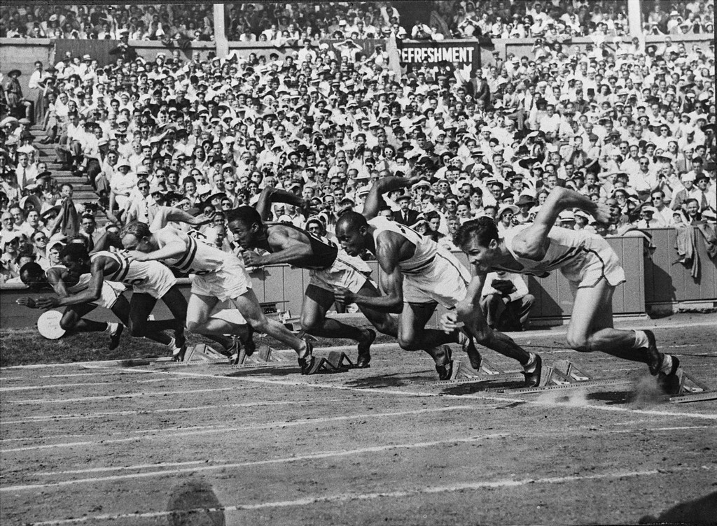 ". This is the start of the 100-meter dash at the Summer Olympics in Wembley stadium, London, July 31, 1948.  American Harrison Dillard, far left, took the gold medal in 10.3 secs., tying the Olympic record.  Right to left; Mel Patton and H. Norwood ""Barney\"" Ewell, U.S.A; Lloyd LaBeach, Panama; Alastair McCorquodale and Emmanuel McDonald Bailey, Great Britain.(AP Photo)"