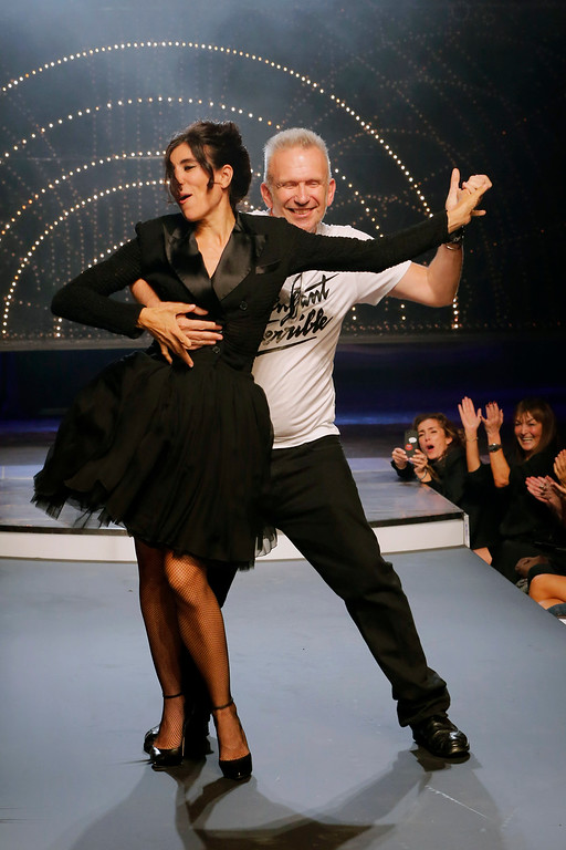 . Fashion designer Jean-Paul Gaultier, right, and choreographer Blanca Li perform a dance, following the presentation of Gaultier\'s ready-to-wear Spring/Summer 2014 fashion collection, Saturday, Sept. 28, 2013 in Paris. (AP Photo/Jacques Brinon)