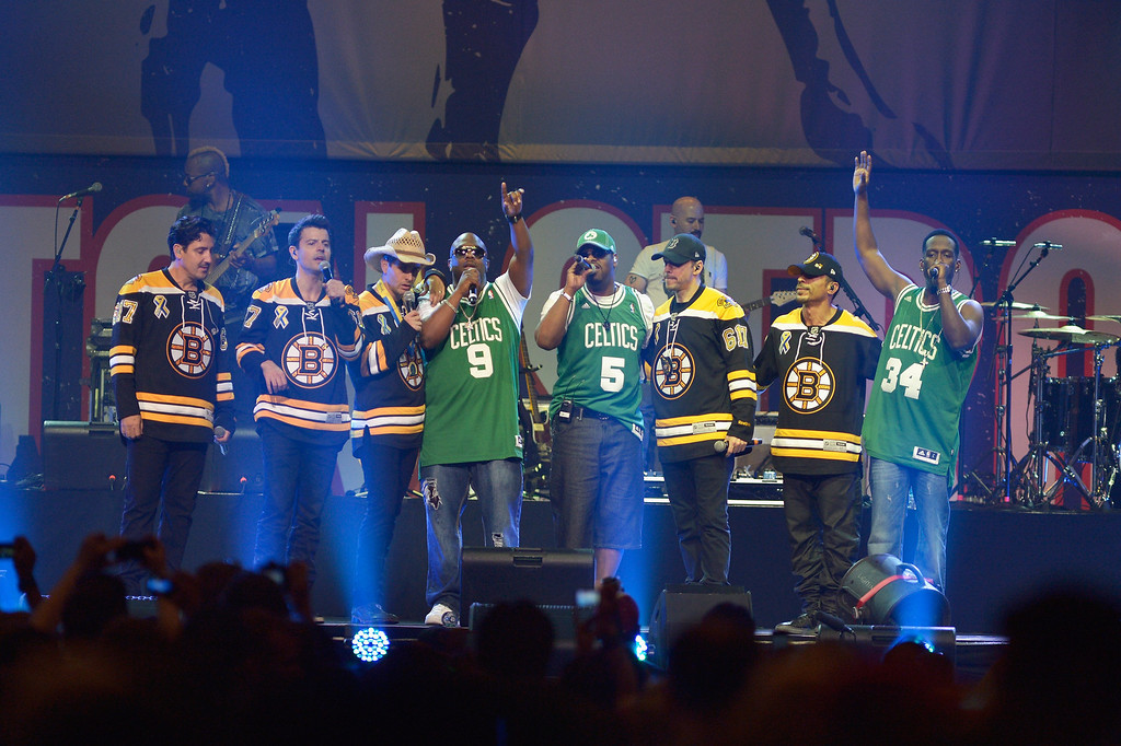 . Boyz II Men perform with New Kids on the Block during the Boston Strong: An Evening Of Support And Celebration at TD Garden on May 30, 2013 in Boston, Massachusetts.  (Photo by Paul Marotta/Getty Images)