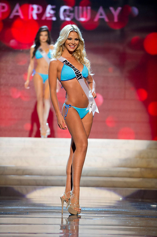 . Miss Paraguay Egni Eckert competes in her Kooey Australia swimwear and Chinese Laundry shoes during the Swimsuit Competition of the 2012 Miss Universe Presentation Show at PH Live in Las Vegas, Nevada December 13, 2012. The 89 Miss Universe Contestants will compete for the Diamond Nexus Crown on December 19, 2012. REUTERS/Darren Decker/Miss Universe Organization/Handout