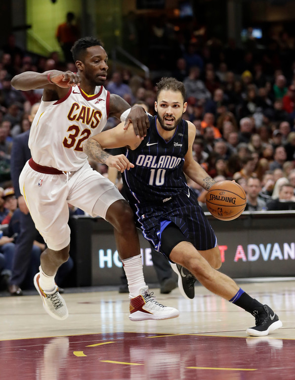 . Orlando Magic\'s Evan Fournier (10) drives against Cleveland Cavaliers\' Jeff Green (32) during the second half of an NBA basketball game Thursday, Jan. 18, 2018, in Cleveland. The Cavaliers won 104-103. (AP Photo/Tony Dejak)