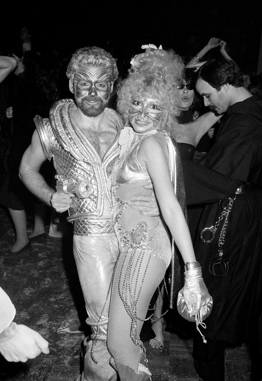 . Halloween revelers at New York\'s Studio 54 dance the night away in costumes ranging from burlesque to stellar. The party was held at the New York Discoteque Oct. 31, 1977. (AP Photo/Richard Drew)