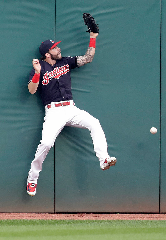 . Cleveland Indians\' Tyler Naquin jumps on the wall but can\'t get to the ball hit by Pittsburgh Pirates\' Corey Dickerson in the second inning of a baseball game, Tuesday, July 24, 2018, in Cleveland. Dickerson hit a two-run triple. (AP Photo/Tony Dejak)
