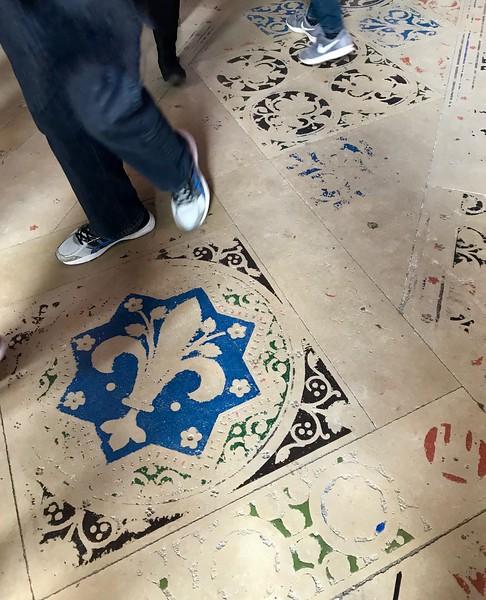 Time-worn tile inside Sainte-Chapelle