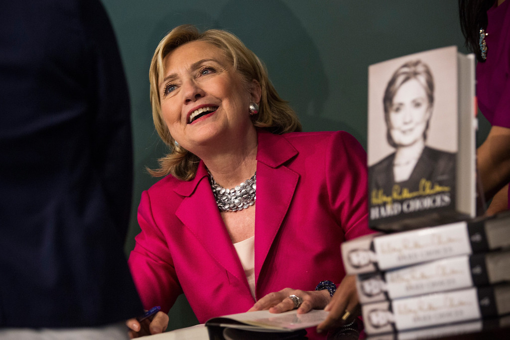 ". Former Secretary of State Hillary Clinton meets with people during a book signing for her new book, ""Hard Choices\"" at a Barnes & Noble on June 10, 2014 in New York City. (Photo by Andrew Burton/Getty Images)"