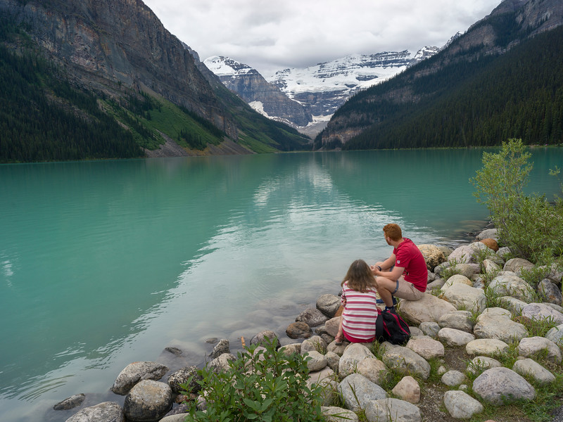 Couple at lakeside, Lake Louise, Improvement District 9, Banff National Park, Jasper, Alberta, Canada