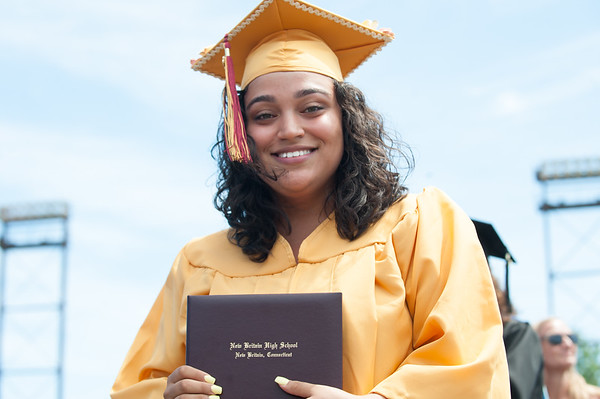 06/19/18 Wesley Bunnell | Staff New Britain High School graduating senior Luz Jimenez smiles after receiving her diploma from teacher Mrs. Wild-Jones during graduation exercises at Veterans' Memorial Stadium at Willow Brook Park on Tuesday morning.