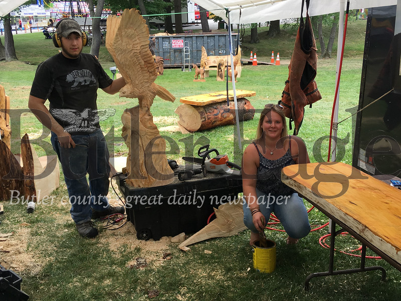 Jake Swanson and Emily Perkins of Vermont work on a wood carving.