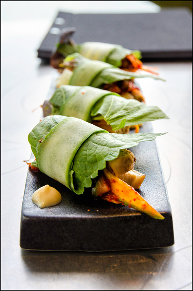Miso braised pork belly, confit garlic, leek, cucumber, kimchi dressing ($22)