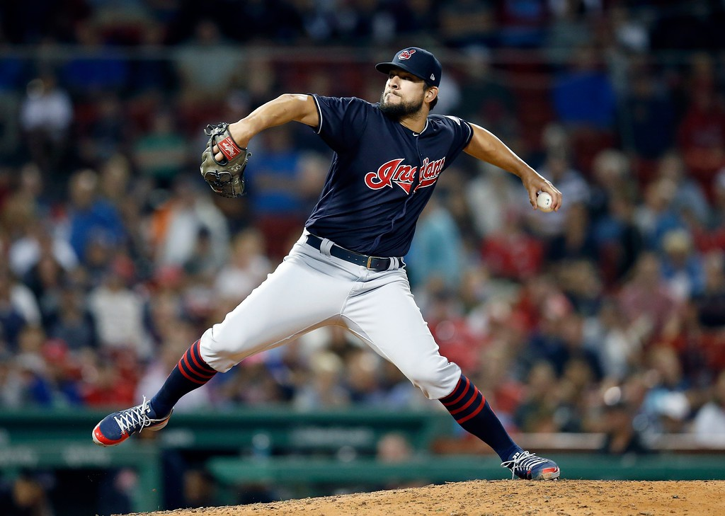 . Cleveland Indians\' Brad Hand pitches during the ninth inning of a baseball game against the Boston Red Sox in Boston, Tuesday, Aug. 21, 2018. (AP Photo/Michael Dwyer)
