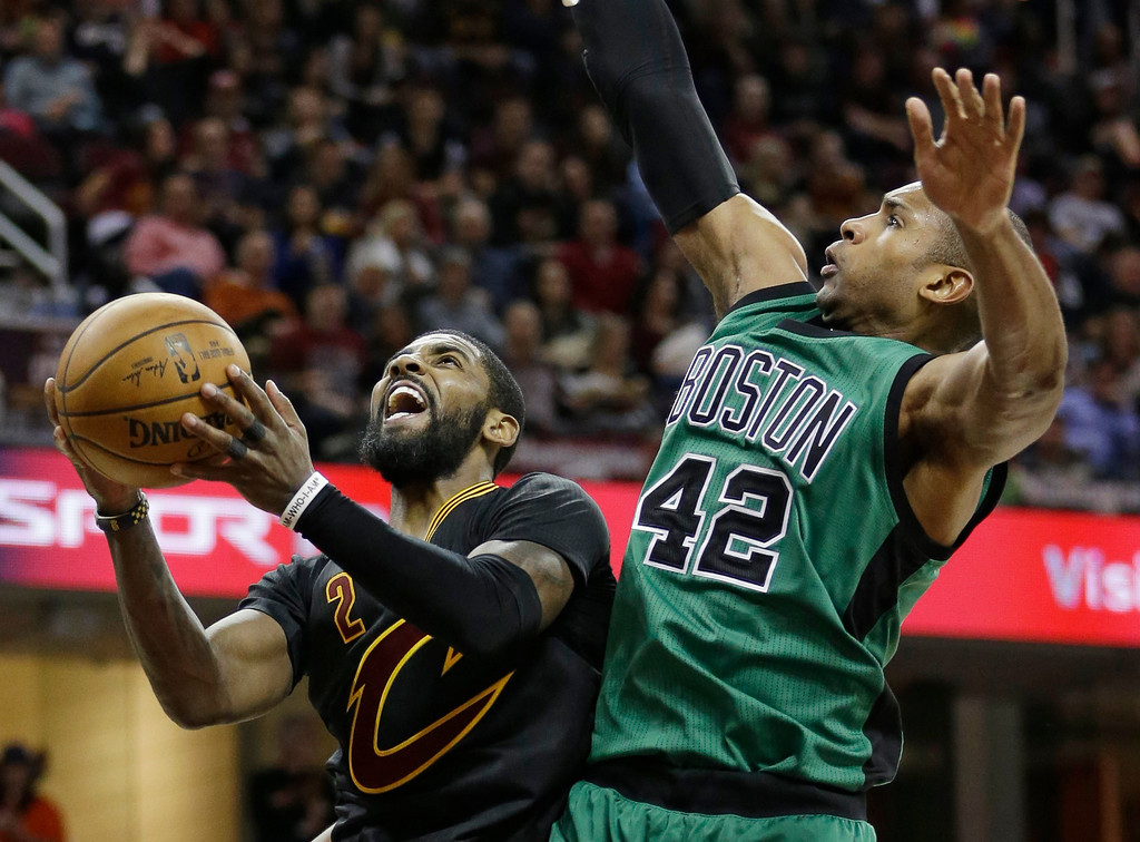 . Cleveland Cavaliers\' Kyrie Irving, left, drives to the basket against Boston Celtics\' Al Horford, from the Dominican Republic, in the second half of an NBA basketball game, Thursday, Dec. 29, 2016, in Cleveland. (AP Photo/Tony Dejak)