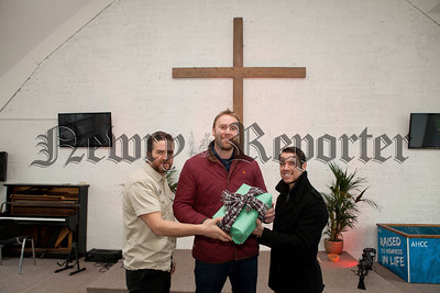 Pictured are David Orr, Pastor Gary Brown and Pauls Burns from the Harvest Church. R1448018