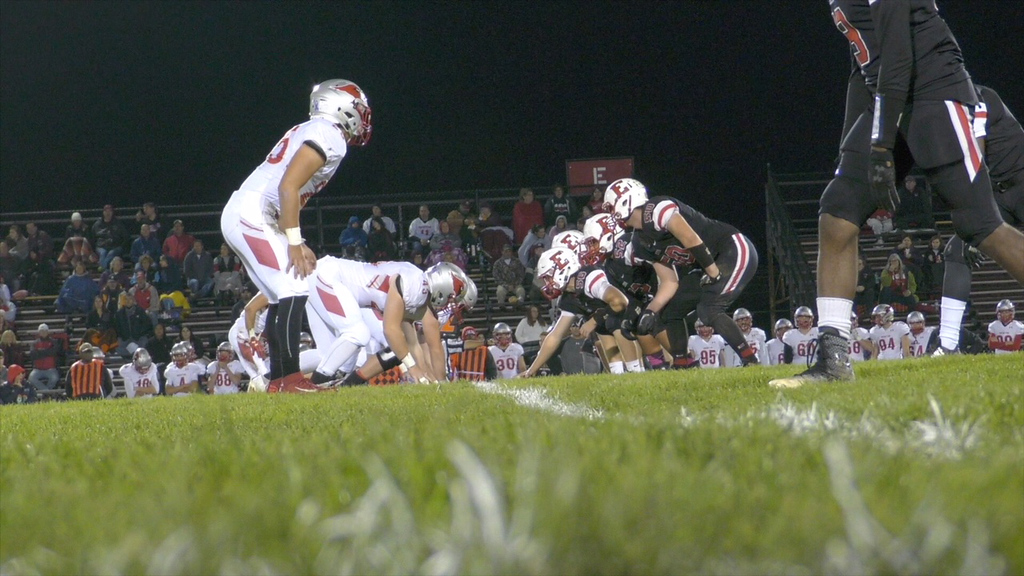. A grass-level view of a game on a grass field at the old Ely Stadium. (Amy Higgins - Elyria City School District)