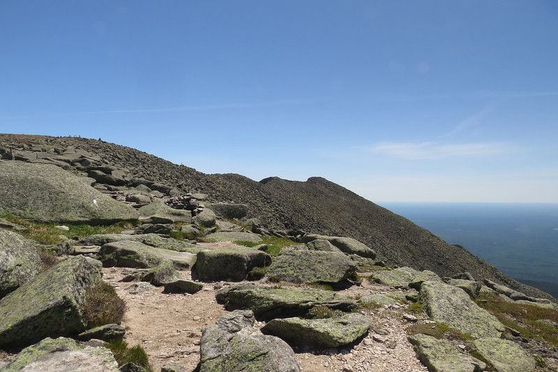 The summit and crowd at left, South Peak at right. We're getting there!.JPG