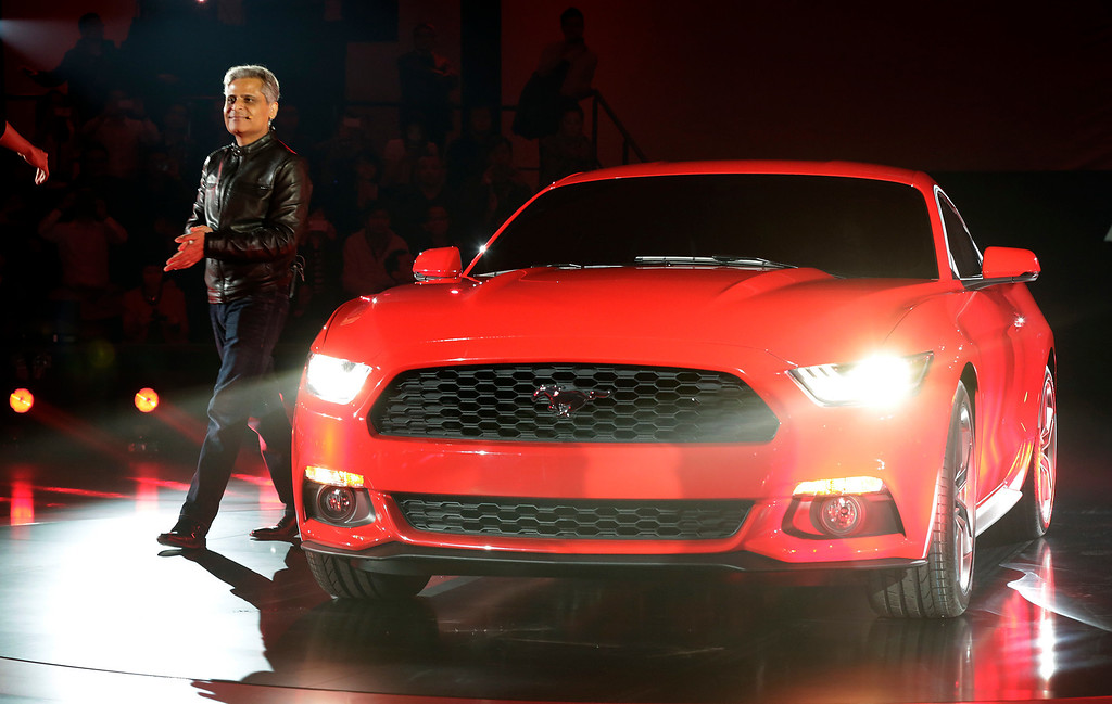 . Kumar Galhotra, Vice President of Engineering, Global Product Development at Ford Motor presents the latest Mustang of the Ford Motor Company to the media at the All-New Ford Mustang Global Reveal event in Shanghai, China, Thursday, Dec. 5, 2013. (AP Photo/Eugene Hoshiko)