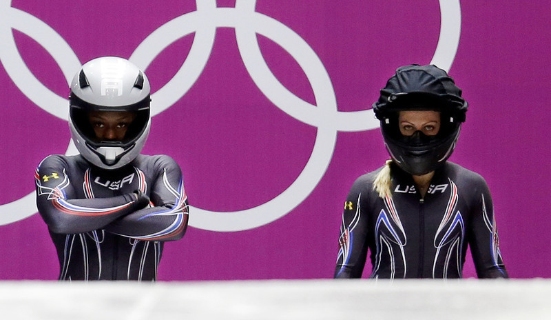 . The team from the United States USA-2, piloted by Jamie Greubel with brakeman Aja Evans, left, prepare to start their third run during the women\'s bobsled competition at the 2014 Winter Olympics, Wednesday, Feb. 19, 2014, in Krasnaya Polyana, Russia. (AP Photo/Natacha Pisarenko)