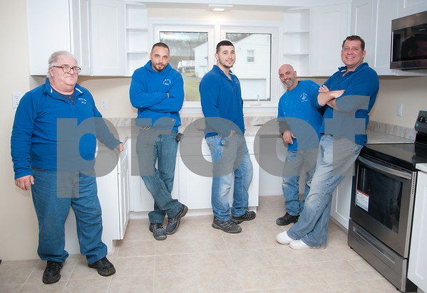 02/20/18 Wesley Bunnell | Staff The crew of Jack of All Trades Remodeling are putting the finishing touches on a remodel on Ronal Drive in Berlin. Rock Rossetti, L, Daniel Brownstein, Co-owner Danny St Laurent, Paul LoRusso and Co-owner Dan St Laurent.