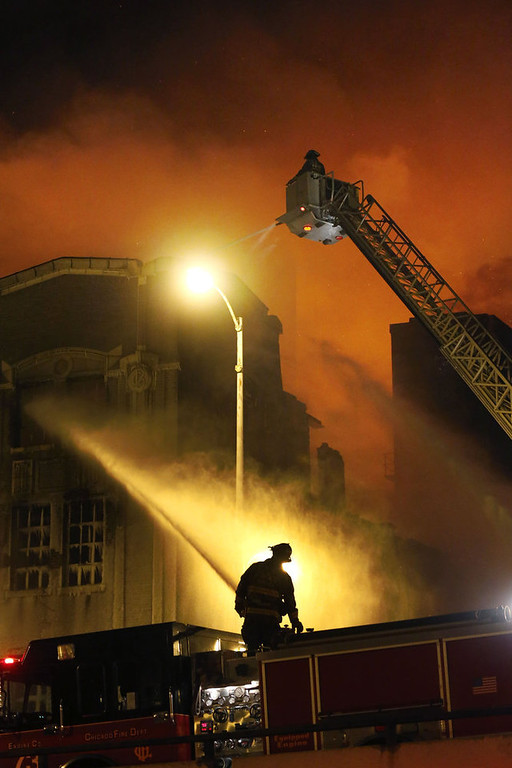 . Chicago firefighters battle a five-alarm blaze in single digit temperatures at a warehouse on the city\'s South Side, Bridgeport neighborhood Wednesday, Jan. 23, 2013, in Chicago. (AP Photo/Charles Rex Arbogast)