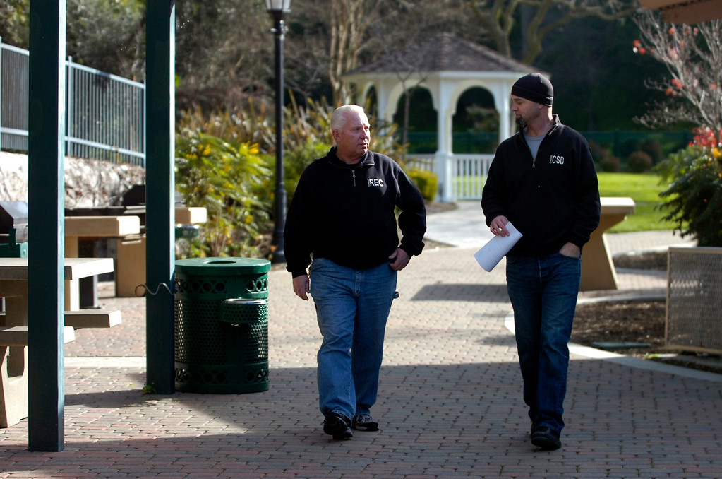 . Crockett Community Services District General Manager Dale McDonald, right, chats with district employee Ron Wilson as they walk through Alexander Park in Crockett, Calif. on Tuesday, Jan. 15, 2013. (Kristopher Skinner/Staff)