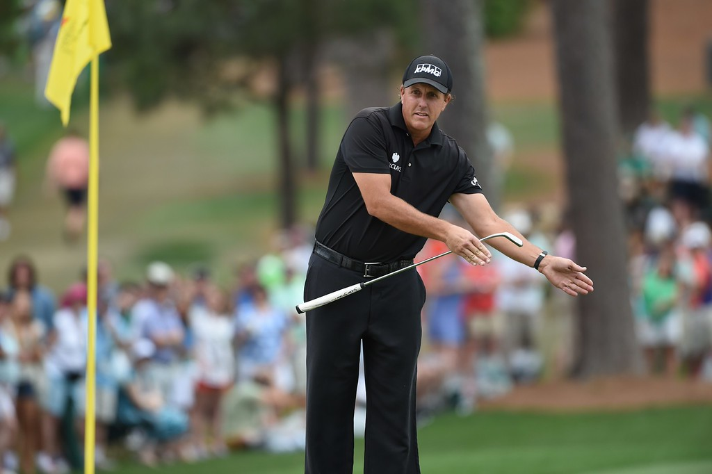 . Phil Mickelson of the US coaches his ball on the 7th hole during Round 4 of the 79th Masters Golf Tournament at Augusta National Golf Club on April 12, 2015, in Augusta, Georgia.  DON EMMERT/AFP/Getty Images