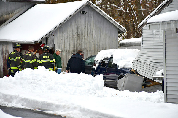 12/4/2019 Mike Orazzi | Staff Bristol fire and police on scene after an elderly driver backed into one building and then drove into another off Wolcott Road in Bristol on Wednesday afternoon. No injuries were reported.
