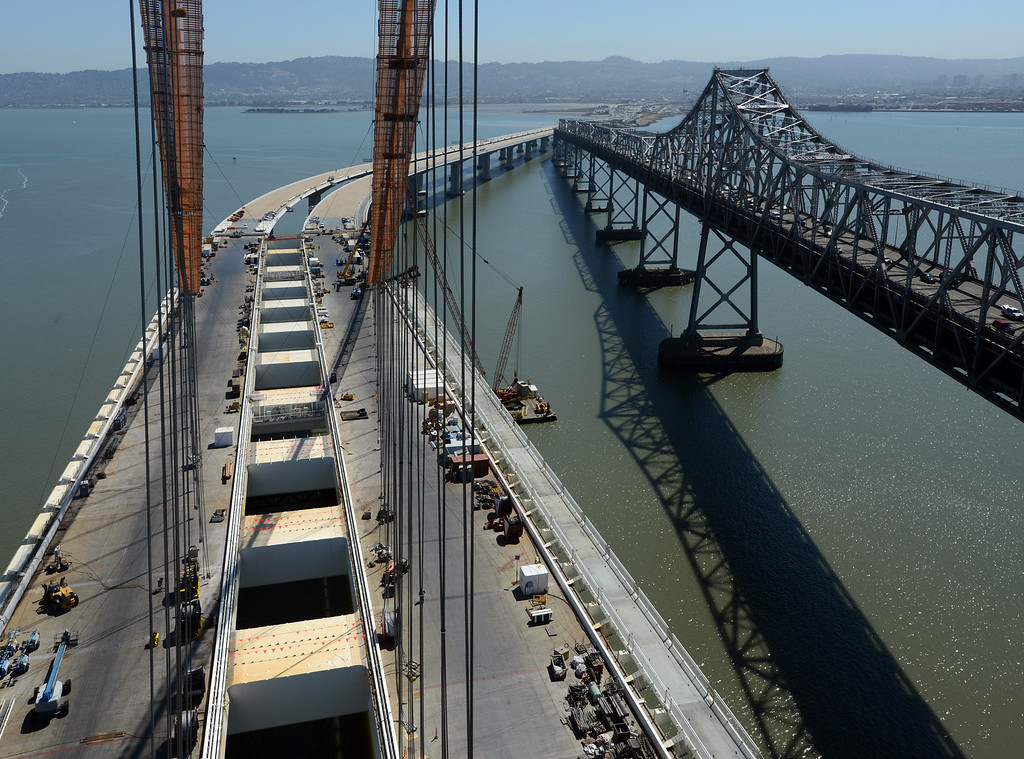 . Suspender ropes dangle from the main cable of the new Bay Bridge Friday morning June 8, 2012 in San Francisco, Calif. (Karl Mondon/Staff)