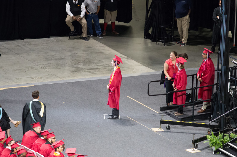 Noah stands in the box for school graduation photos after receiving his diploma (cover) -- Noah Friedlander - June 6, 2017 graduation from Montgomery Blair High School - Magnet Program for Math, Science, and Computer Science, Xfinity Center, University of Maryland, College Park.
