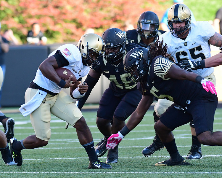 Jaboree Williams and Willie Yarbary tackle A Bradshaw.jpg