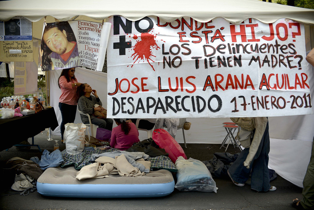 . Part of a group of mothers taking part in a hunger strike are seen in a tent in front of the Attorney General building in Mexico City on May 9, 2013. The mothers are demanding that the government investigate the disappearance of their children, which they say have gone missing due to the drug war that the government started in 2006. YURI CORTEZ/AFP/Getty Images