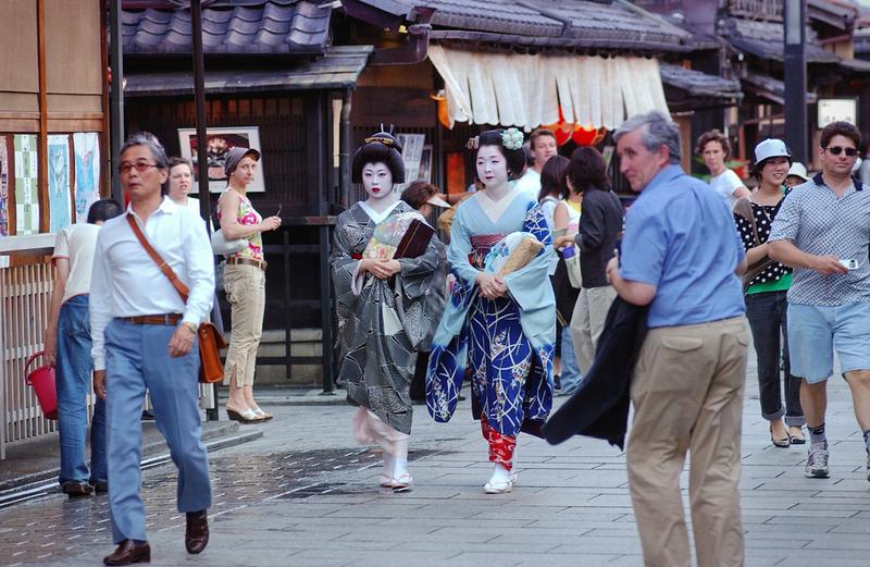 Maiko geisha walking on a street of Gion. Editorial credit: MikeDotta / Shutterstock.com