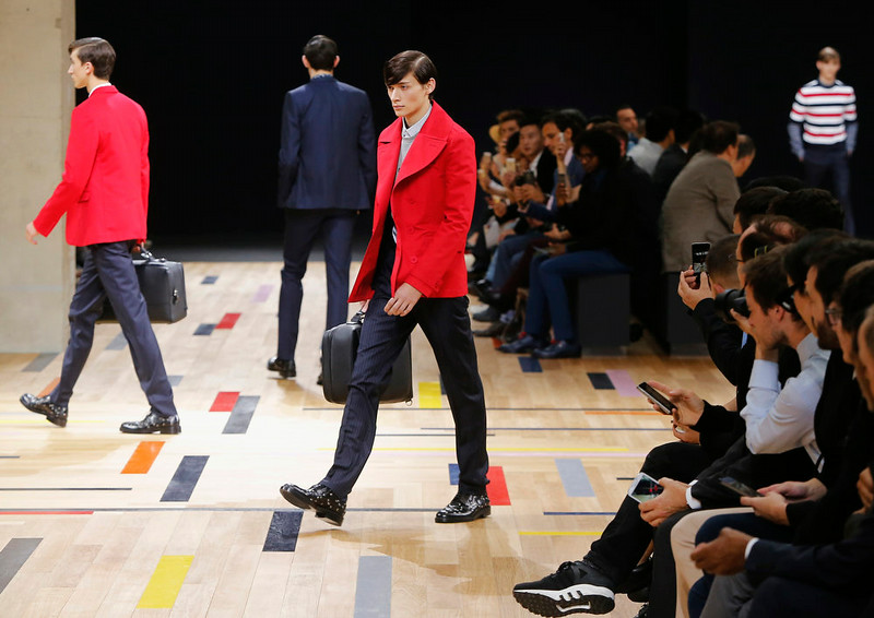 . Models wear creations by Belgian designer Kris Van Assche as part of Dior Homme menís Spring-Summer 2015 fashion collection, presented in Paris, Saturday, June 28, 2014. (AP Photo/Jacques Brinon)