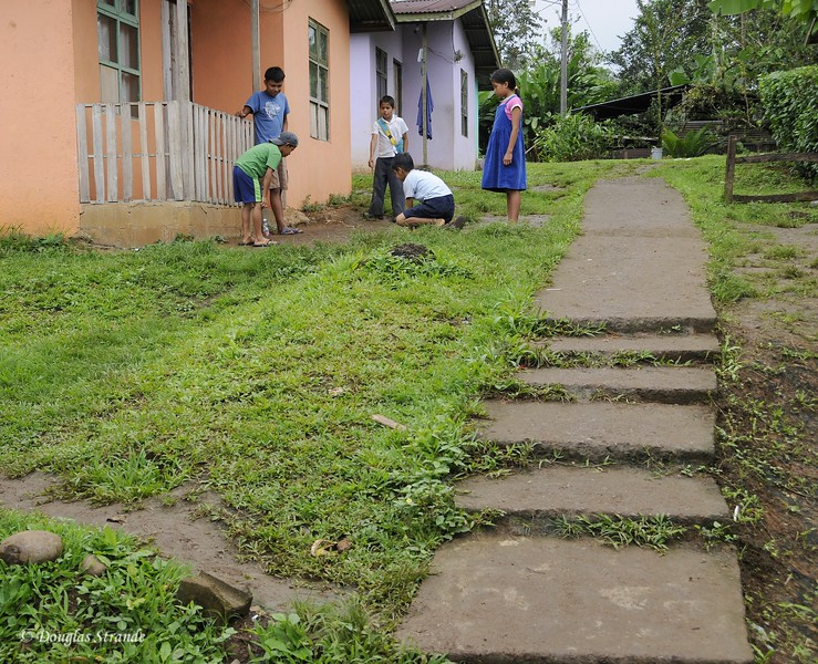 Maleku Village: boys playing marbles