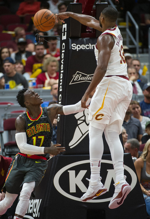 . Cleveland Cavaliers\' Tristan Thompson blocks a shot by Atlanta Hawks\' Dennis Schroder (17) during the first half of an NBA pre-season basketball game in Cleveland, Wednesday, Oct. 4, 2017. The Hawks won 109-93. (AP Photo/Phil Long)