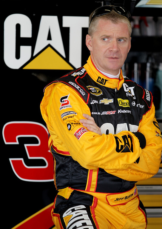 . DAYTONA BEACH, FL - FEBRUARY 20:  Jeff Burton, driver of the #31 Caterpillar Chevrolet, stands in the garage during practice for the NASCAR Sprint Cup Series Daytona 500 at Daytona International Speedway on February 20, 2013 in Daytona Beach, Florida.  (Photo by Todd Warshaw/Getty Images)