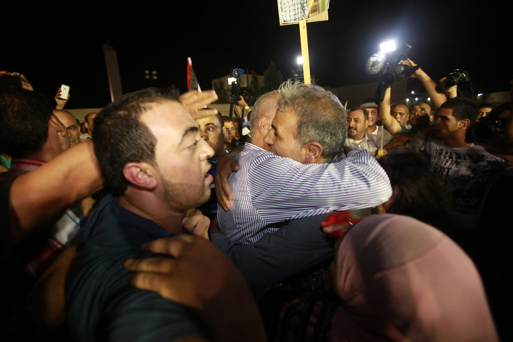 . Families of prisoners freed from Israeli detention celebrate in the city of Ramallah on August 13, 2013. The release of the prisoners, all but one of whom were jailed before the Palestinian Authority was formed in 1994, has been hailed by Palestinian negotiators but has incensed some Israeli officials.   ABBAS MOMANI/AFP/Getty Images