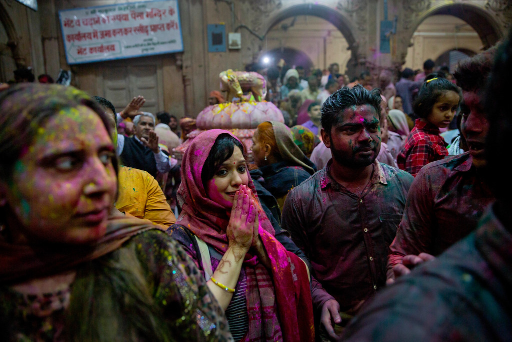 . Hindu devotees smeared with colours pray inside Banke Bihari temple, dedicated to Lord Krishna, during Holi festival celebrations in Vrindavan, India, Wednesday, March 8, 2017. Holi, the festival of colors, celebrates the arrival of spring. (AP Photo/Manish Swarup)