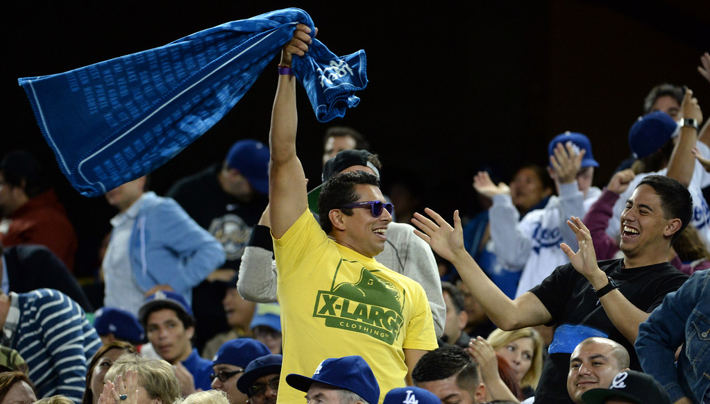 . A Los Angeles Dodgers fan swing the rally towel in the seventh inning of a baseball game against the Philadelphia Phillies on Tuesday, April 22, 2013 in Los Angeles.   (Keith Birmingham/Pasadena Star-News)
