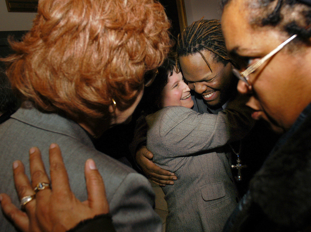 ". TRENTON, NJ - JANUARY 12:  Gay Rights activists celebrate after New Jersey Governor James E. McGreevey signed the ""Domestic Partnership Act\"" into law in his office at the New Jersey Statehouse January 12, 2004 in Trenton, New Jersey. Under the \""Domestic Partnership Act\"" rights and legal protections will be granted to same-sex couples and elderly, opposite-sex domestic partners who share residence and basic living expenses.  (Photo by William Thomas Cain/Getty Images)"