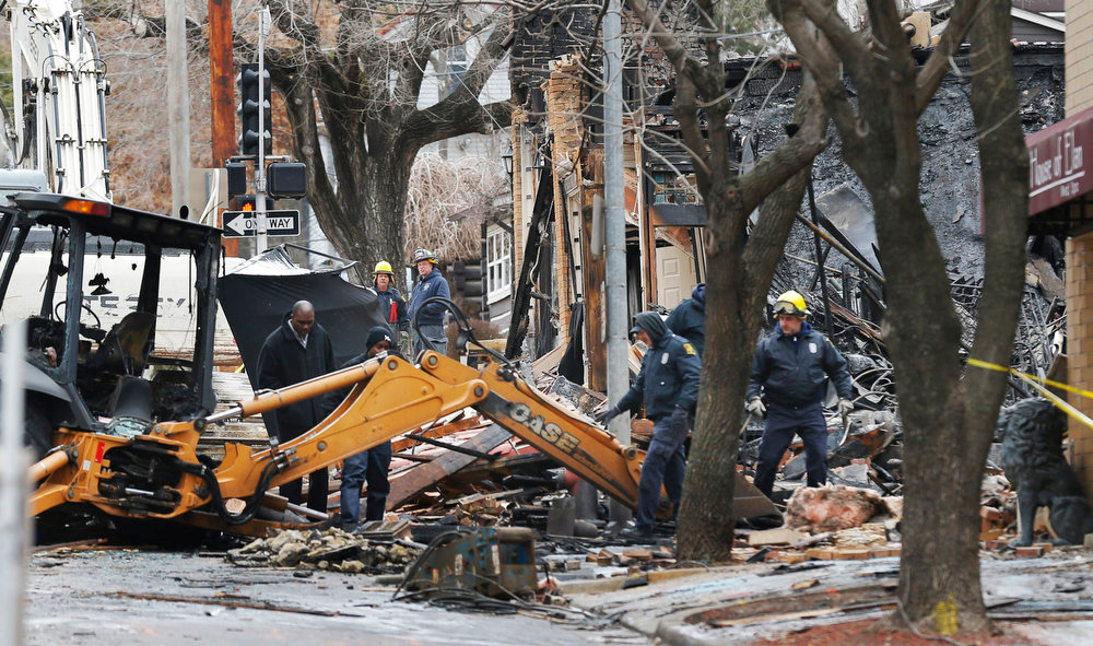 . Officials inspect a burned out  JJ\'s Restaurant at the Plaza shopping district of Kansas City, Mo., Wednesday, Feb. 20, 2013.  Search crews at the site of the massive explosion that destroyed the restaurant,  recovered one body Wednesday, and the city\'s mayor said there was no certainty the rubble wasn\'t concealing other victims. Mayor Sly James declined to say whether the body belonged to a man or a woman, though authorities have been looking for a woman who worked at JJ\'s restaurant and was seen there before the Tuesday evening blast and reported missing afterward.  A natural gas leak turned into an explosion that leveled the building on Tuesday evening. (AP Photo/Orlin Wagner)